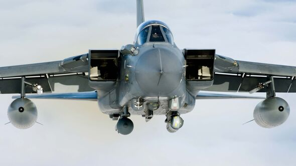 A Tornado GR4 from 125 Squadron based at RAF Lossiemouth soars high above the clouds