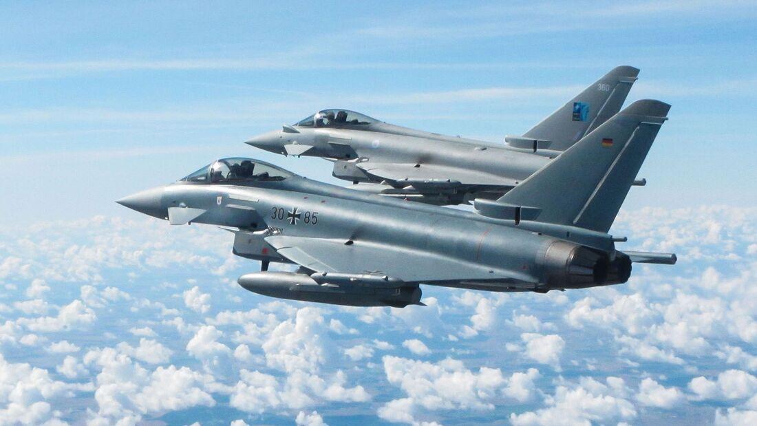 Deutsche und britische Eurofighter fliegen gemeinsam in Ämari.