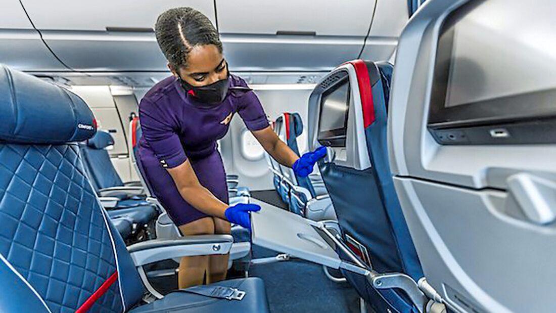 Flight Attendant checks cleanliness of plane