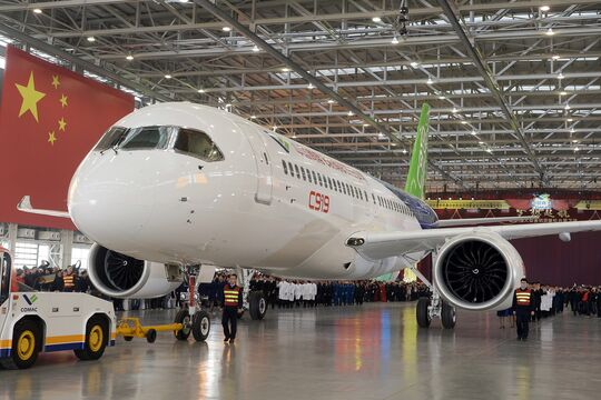 People Celebrate The Rolling Off Of The First C919 Passenger Jet Plane In China