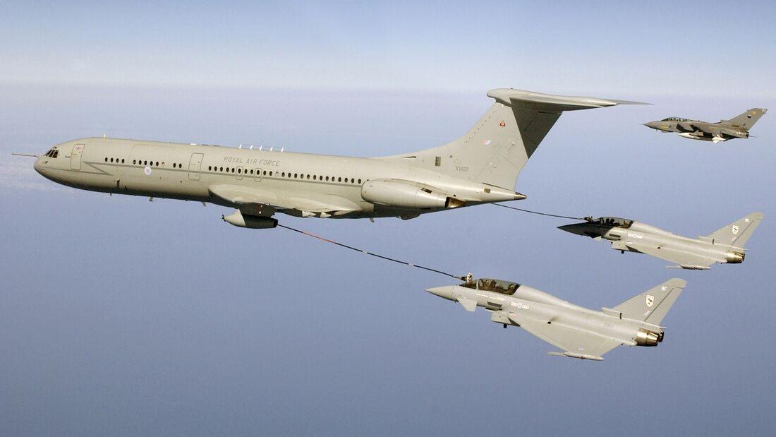 Two Typhoon fighters refuel in mid air with a VC 10 aircraft